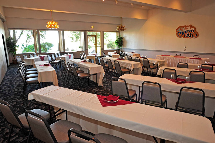 banquet space with rows of tables and chairs at Shilo Inns Richland